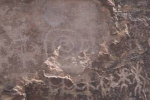 "Photo by Tom Herrick of equinox ""sun dagger"" on spiral petroglyph at Picture Rocks site, Pima County, Arizona."