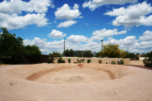 An excavated and reconstructed Hohokam ballcourt at the Pueblo Grande archaeological site in Phoenix; photograph provided by Todd W. Bostwick